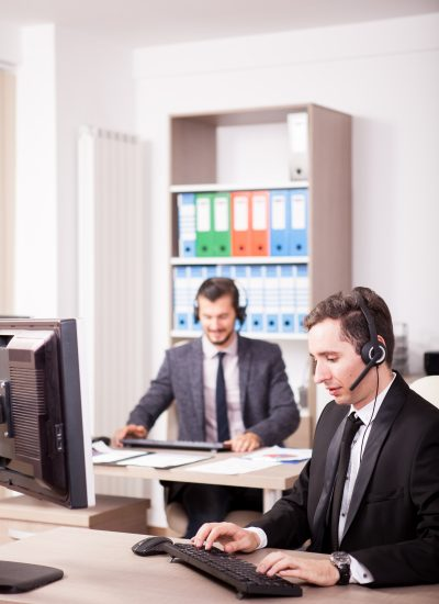 Customer service support working in office. Professional online and telephone assistant support