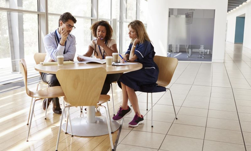 Senior healthcare workers in consultation in a meeting room